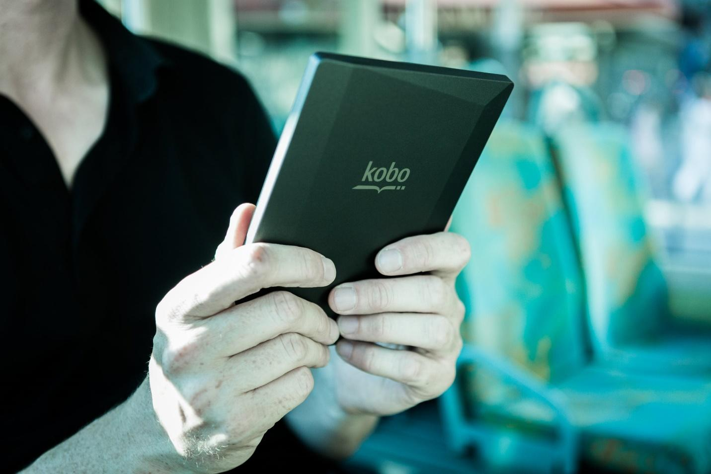 Person Holding Black Kobo Tablet
